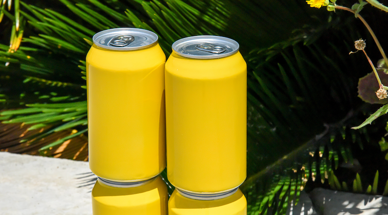 two yellow cans of drink